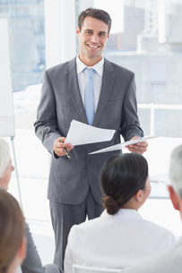 Happy businessman looking at camera during meetingの素材 [FYI00007542]