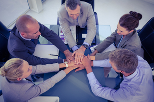 Business team putting their hands togetherの写真素材 [FYI00007672]