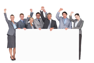 Excited business team holding posterの写真素材 [FYI00007739]