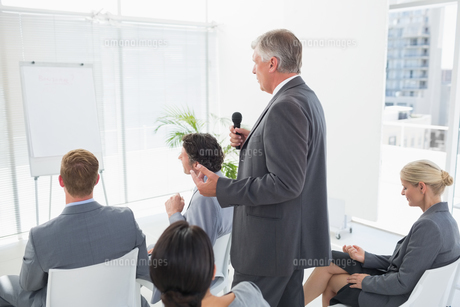 Businessman talking in microphone during conferenceの素材 [FYI00007746]