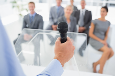 Businessman talking in microphone during conferenceの素材 [FYI00007749]
