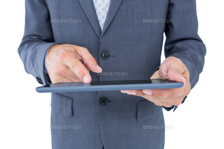 Close up view of businessman using tablet computerの素材 [FYI00007900]