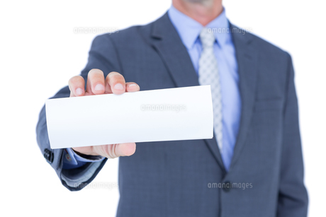 Businessman holding a white signの素材 [FYI00007906]
