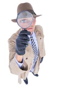 Spy looking through magnifierの写真素材 [FYI00007911]