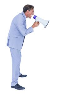 Businessman talking through megaphoneの写真素材 [FYI00007920]