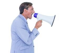 Businessman talking through megaphoneの写真素材 [FYI00007922]
