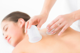 Pretty woman enjoying suction massageの素材 [FYI00008221]
