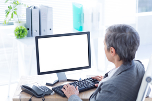 Businesswoman working on computerの写真素材 [FYI00008281]
