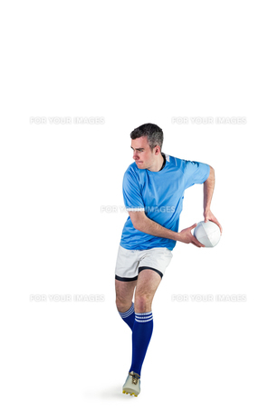 Rugby player doing a side passの写真素材 [FYI00008670]