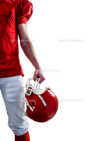 An american football player taking his helmet on handの素材 [FYI00008687]