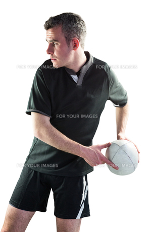 Rugby player doing a side passの写真素材 [FYI00008690]