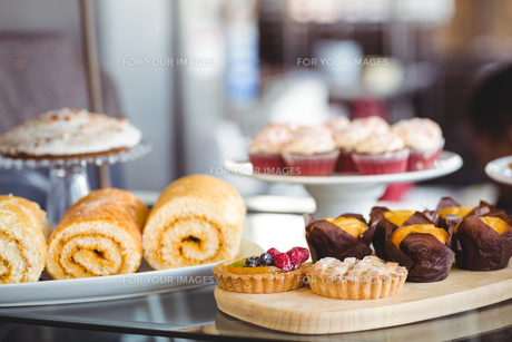 Close up of pastries on plates on counterの写真素材 [FYI00008756]