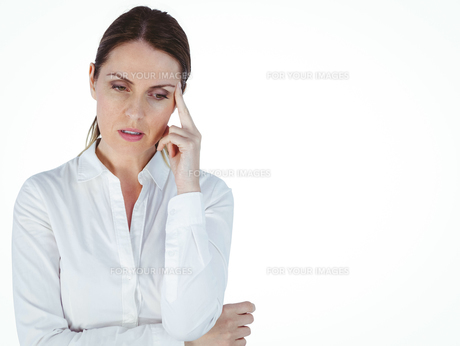 Beautiful businesswoman thinking with finger on headの素材 [FYI00009623]