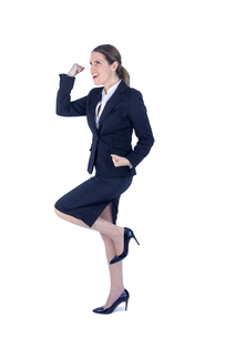 Pretty businesswoman doing a running victory poseの写真素材 [FYI00009624]