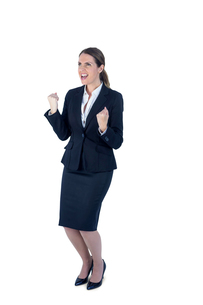 A businesswoman cheering and yellingの素材 [FYI00009630]
