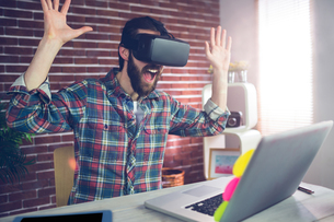 Surprised creative businessman wearing 3D video glassesの写真素材 [FYI00009669]