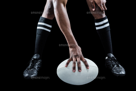 Low section of athlete playing rugbyの写真素材 [FYI00009720]