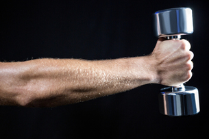Cropped image of man working out with dumbbellの写真素材 [FYI00009724]