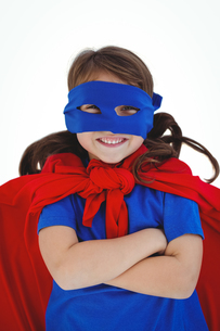 Masked girl with arms crossed pretending to be superheroの写真素材 [FYI00009879]