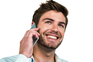 Smiling man on phone callの写真素材 [FYI00010117]
