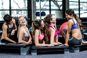 Group of fit woman smiling while lying on the floorの写真素材 [FYI00010119]