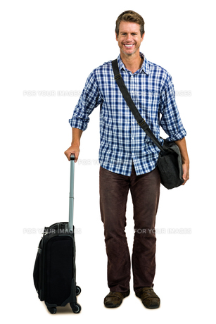 Full length of cheerful man with luggageの写真素材 [FYI00010207]