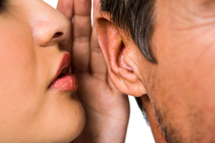 Woman whispering in man earの写真素材 [FYI00010210]