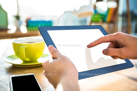 Cropped image of hipster businessman using tabletの写真素材 [FYI00010261]