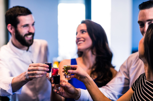 Friends toasting with alcohol shotsの写真素材 [FYI00010359]