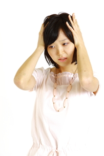 ショックを受ける女性の写真素材 [FYI00035589]