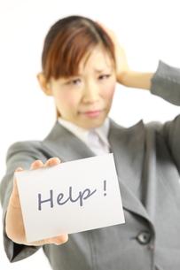 助けを求めるビジネスウーマンの写真素材 [FYI00035928]