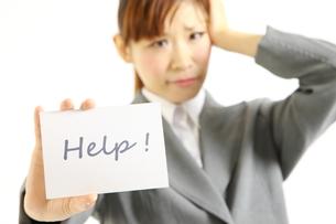 助けを求めるビジネスウーマンの写真素材 [FYI00035933]