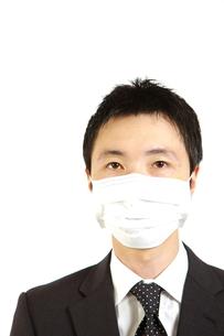 マスクをするビジネスマンの写真素材 [FYI00036146]