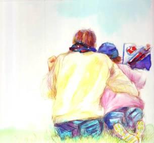 チームの旗を持ち仲良く応援する親子の写真素材 [FYI00058239]