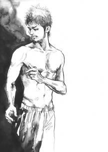 自分の身体を見る男性の写真素材 [FYI00058243]