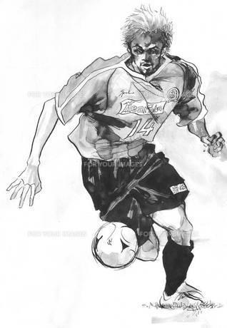 ドリブルをしながら攻め込むサッカー選手の素材 [FYI00058252]