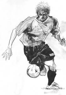 ドリブルをしながら攻め込むサッカー選手の写真素材 [FYI00058252]