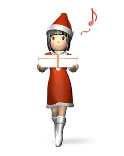 クリスマスプレゼントを抱える女性の写真素材 [FYI00068995]