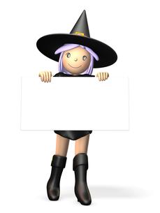メッセージボードを持ったハロウィン魔法使いの写真素材 [FYI00069135]