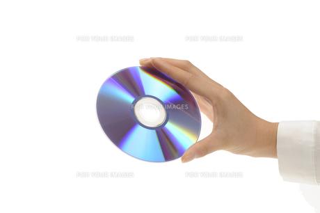 DVDを持つ手の素材 [FYI00073529]