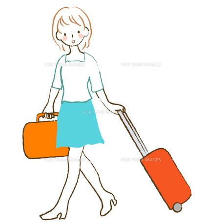 キャリーバッグを引く女性の素材 [FYI00075894]