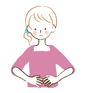 お腹を押さえる女性の素材 [FYI00075923]