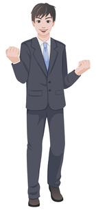 スーツを着てガッツポーズをする若い男性の写真素材 [FYI00124509]