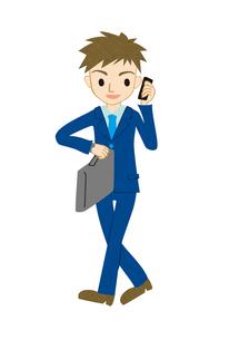 電話する若い男性の写真素材 [FYI00125961]