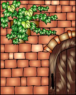 木戸のあるレンガ壁にツタの葉の写真素材 [FYI00144916]