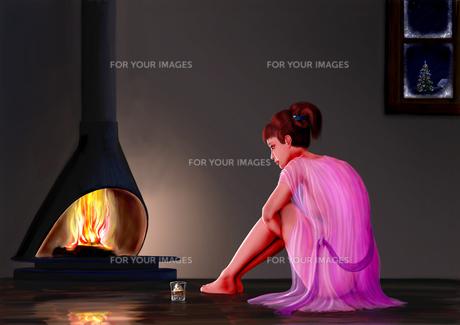 暖炉の前の女の写真素材 [FYI00156406]