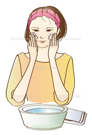 洗顔する若い女性の写真素材 [FYI00180044]