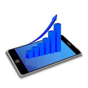 スマートフォンとグラフの写真素材 [FYI00181337]