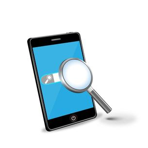 スマートフォンと虫眼鏡で検索の写真素材 [FYI00181342]