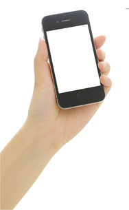 スマートフォンを持つ手の写真素材 [FYI00186489]